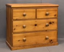 VICTORIAN PINE CHEST OF TWO SHORT OVER TWO LONG DRAWERS - with turned wooden knobs on a plinth base,