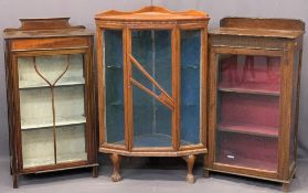 THREE VINTAGE CHINA DISPLAY CABINETS to include a single door oak example with railback and interior
