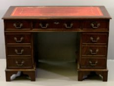 REPRODUCTION DESK with tooled red leather effect top, twin pedestals and a central drawer, 77cms