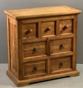RUSTIC PINE CHEST with seven small drawers, 76cms H, 75cms W, 38cms D