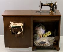VINTAGE SEWING CABINET with Jones hand crank sewing machine and haberdashery contents, 80cms H,
