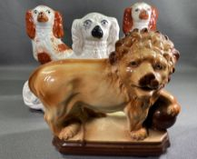STAFFORDSHIRE LION, a pair of red and white Staffordshire comforter dogs, 34cms H and another
