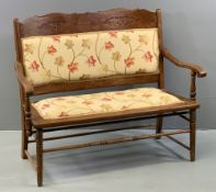 VINTAGE BENCH - two seater with carved detail and upholstery to the back, upholstered seat, on