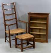 STRUNG SEATED ELBOW CHAIR with ladderback, 100cms H, 58cms W, 38cms D and a similar footstool, 30cms