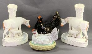 STAFFORDSHIRE - a pair of cow spillholders, 29cms H and two hens on nests