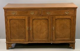 OAK SIDEBOARD BASE with three fielded panel cupboard doors and two drawers above with brass drop