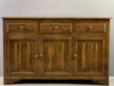 LINENFOLD SIDEBOARD BASE with three drawers over three base cupboards, 84cms H, 136cms W, 40cms D