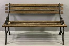GARDEN BENCH with cast metal ends and wooden slats, 69cms H, 123cms W, 55cms D