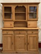 FARMHOUSE PINE TYPE DRESSER with upper glazed doors and central shelves over a three door and drawer