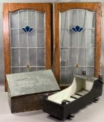 ANTIQUE WOODEN DOLL'S COT, beaten brass slipper box and a pair of leaded stained glass doors/panels,
