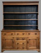 NORTH WALES DRESSER having a three shelf rack over a T-Bank of three over three drawers and two side