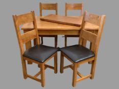 MODERN DINING FURNITURE - oak extending table, 78cms H, 180cms W, 90cms D (open) and a set of four