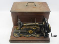 ANTIQUE SINGER HAND CRANK SEWING MACHINE - in slide-out case