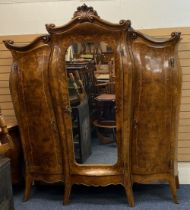 LOUIS XV STYLE FRENCH WALNUT BOMBE SHAPED WARDROBE - having central mirrored door and two outer