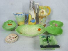 ART DECO POTTERY GROUP including a Flaxman ware, and other hand painted jugs, Carltonware Beswick