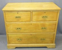 CIRCA 1900 OAK CHEST OF TWO SHORT OVER TWO LONG DRAWERS - having brass backplates and swing handles,