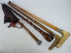 SILVER MOUNTED PARASOL, a 19th century clasped hand walking stick and two antler handled sticks