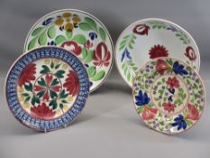 FOUR ANTIQUE SPONGEWARE CIRCULAR SHALLOW DISHES, colourfully floral decorated, two in the manner