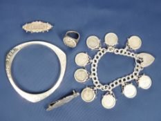 SILVER & WHITE METAL JEWELLERY, 5 ITEMS to include a padlock clasp charm bracelet holding 9 frame