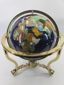 MODERN GEMSTONE GLOBE - in a brass effect gimbal stand, 50cms H, 43cms diameter approximately the