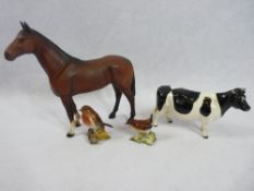 BESWICK POTTERY ORNAMENTS (4) to include 'Champion Claybury Leegwater' cow, 'The Winner' standing