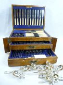 OAK CASED TABLE CANTEEN OF CUTLERY, one hundred piece, within a fitted lidded top and two drawers