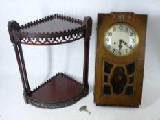 CLOCKS - Enfield 8 day polished wall clock and a mahogany fretwork corner wotnot