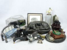 HEAVY COMPOSITION MODEL OF A SLEEPING HOUND - on a base, 40cms L, a mineral desk stand and an