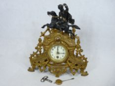 FRENCH CLOCK - Ormolu with mythical horse rider to the top, 34.5cms tall