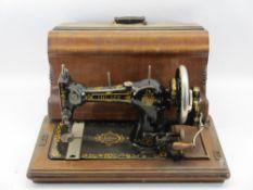G H LEE & CO LTD LIVERPOOL 'The Lee' hand crank sewing machine in walnut case