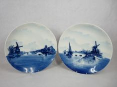 ROSENTHAL BLUE & WHITE DELFT WALL CHARGERS, A PAIR - typically decorated Dutch scenes with