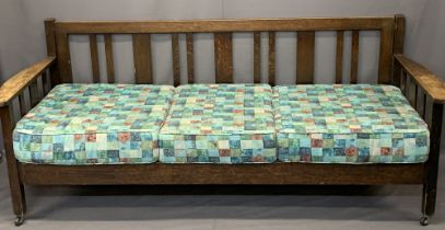 HEAL & SON LTD LONDON VINTAGE OAK DAYBED - 83.5cms max H, 204cms W, 77cms overall D, 71cms seat D,