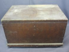 ANTIQUE PINE LIDDED CAPTAIN'S STYLE CHEST - with iron carry handles on a plinth base with metal