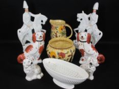 STAFFORDSHIRE DOGS, two pairs, 24cms H the tallest, a pair of Staffordshire flatback horse and rider