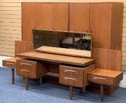 MID-CENTURY G PLAN BEDROOM SUITE, 4 PIECE - a triple wardrobe, 175cms H, 122cms W, 59cms D, double