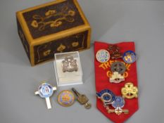 GIRL GUIDES BADGES - a collection in a pokerwork wooden box and a vintage pocket watch key