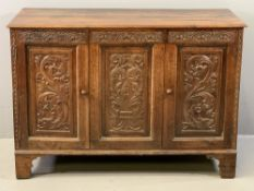 ANTIQUE CARVED OAK TWO DOOR SIDEBOARD (ex-coffer), the moulded edge top over a central panel and