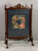CARVED MAHOGANY FIRESCREEN with barley twist side supports, 110cms H, 76cms W