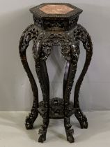 CHINESE CARVED HARDWOOD STAND with inset marble top, hexagonal top detail over six floriate carved