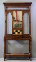 VICTORIAN HALLSTAND - having a central mirror and tiled section, a single drawer and drip trays,