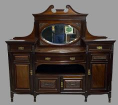 EDWARDIAN MAHOGANY MIRROR BACKED SIDEBOARD - having a bow front and carved detail, 169cms H,