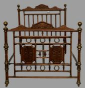 EARLY 20th CENTURY FRENCH 4ft 6ins BEDSTEAD in turned and carved wood with brass embellishments,