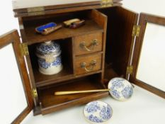 EDWARDIAN OAK SMOKER'S CABINET, fitted drawers and compartments with printed pottery tobacco jar,