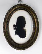 ATTRIBUTED TO HOUGHTON & BRUCE (British fl. 1792-1796) SILHOUETTE PORTRAIT MEDALLION. of a young
