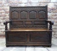 ANTIQUE JOINED OAK BOX SETTLE, panelled back and front profusely carved with foliage, lift up