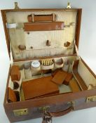 VINTAGE PIGSKIN GENTLEMAN'S VANITY CASE, ribbed cloth interior fitted with compartments for toilette