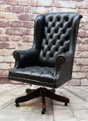 NORWEGIAN LEATHER DESK CHAIR, button upholstered in black with swivel base Condition: arms and