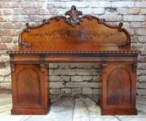 LATE VICTORIAN WALNUT PEDESTAL SIDEBOARD, scrolled back above ripple moulded top and three cushion