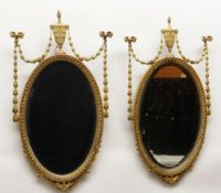 PAIR VICTORIAN NEOCLASSICAL-STYLE GILT GESSO WALL MIRRORS, tops with urns suspending ribbon-tied