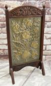 ARTS & CRAFTS EMBOSSED BRASS & OAK FIRE SCREEN, decorated with vase of flowers, foliate carved